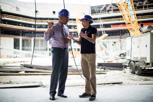 Sacramento Mayor Kevin Johnson, left, and Sacramento Kings owner Vivek Ranadive, center, at the site of Sacramento's new sports arena.  Credit Max Whittaker for The New York Times