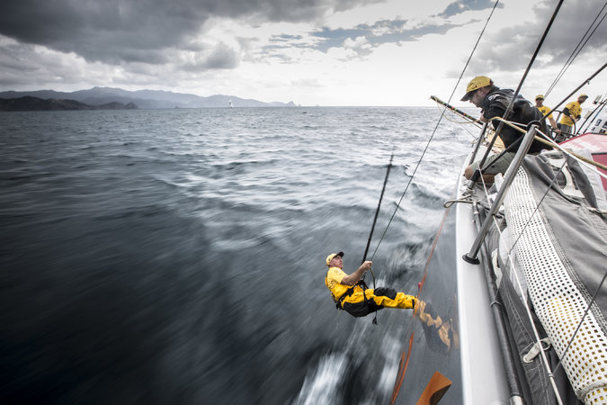 Phil Harmer of Abu Dhabi Ocean Racing checked the keel for debris in the Bay of Plenty near New Zealand during the Volvo Ocean Race. Credit Getty Images AsiaPac, via Ainhoa Sanchez/Volvo Ocean Race