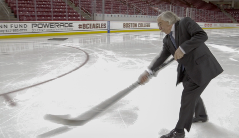 Energy Secretary Ernest Moniz takes a slap shot at Boston College's Conte Forum to promote green sports arenas. | Photo by Simon Edelman, Energy Department.