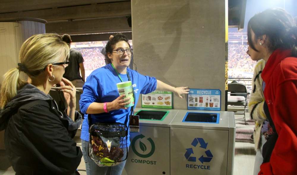 Alana Levine (center), Arizona State University's assistant director in facilities development and management, shows off Sun Devil Stadiums' recycling and compost bins UA campus sustainability program coordinator Julia Rudnick (left) and student Celeste Colmenares (right) Nov. 10 in Tempe. Sun Devil Stadium recycles 50% of its waste.