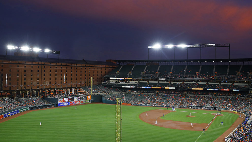 Dusk settles over Oriole Park at Camden Yards as the Baltimore Orioles and the Toronto Blue Jays play in the third inning of a baseball game in Baltimore, Wednesday, April 5, 2017. (AP Photo/Patrick Semansky)