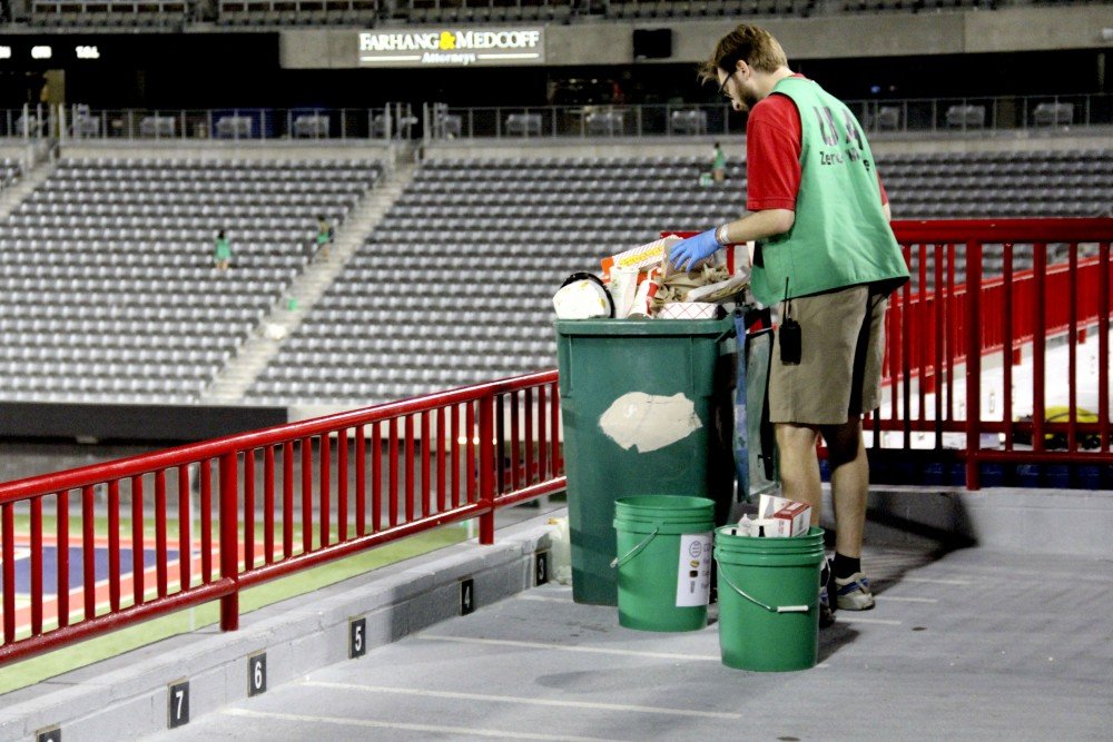Ben Champion, director of the Office of Sustainability, sorts waste from the PAC-12 Zero Waste challenge during the homecoming football game on Oct. 29, 2016. The UA Office of Sustainability alongside student organizations help solve the problem of removing trash from campus and the football stadium every year.