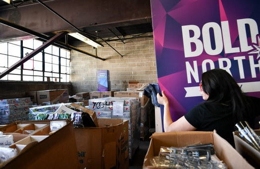 he Salvation Army is acting as a distribution hub for Super Bowl LII leftovers. Above, marketing director Michelle Wong with some of the donated items and food.