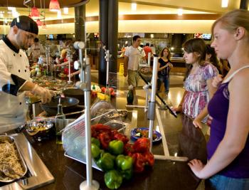 Chantel Lawrence (right) and Tracie Smith have a stir fry prepared just for them in the Barrett Honors College dining facility.