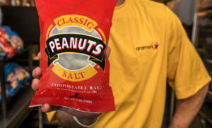 The new bright red peanut bag designed using certified compostable materials is replacing the standard laminated polypropylene peanut bag currently available at stadiums. (Image courtesy of Amarak)