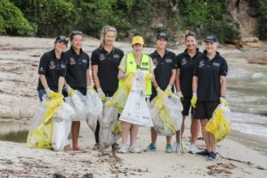 The crew, joined by Clean Up Australia, gathered on Whiting Beach in Sydney Harbor. Pictured from left to right: Libby Greenhalgh, Sarah Wilmot, Sophie Ciszek, Terrie-Ann Johnson (Managing Director and CEO of Clean Up Australia), Stacey Jackson, Dee Caffari, and Vanessa Dudley. Photo credit: Salty Dingo/Ocean Respect Racing